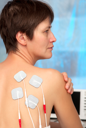 electrodes of tens device on the woman's back, tens therapy, ner