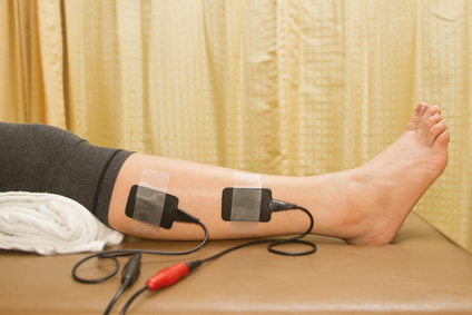 Physical therapy , woman with eletrical stimulator for treament